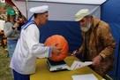 Рязанский весовщик на «Спожинках» сравнил вес тыквы и полковника