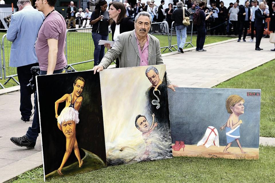 На референдуме в Британии уже зарабатывают уличные художники. Пользуются спросом картины с Кэмероном и Меркель. Фото: PA Wire/Press Association Images/TASS