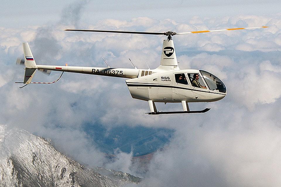 Вертолёт Robinson в воздухе. Фото предоставлено пресс- службой вертолетного центра Heli Club