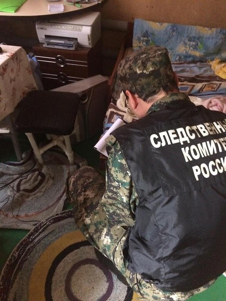 Следователи на месте преступления. Фото: СУ СКР по Свердловской области