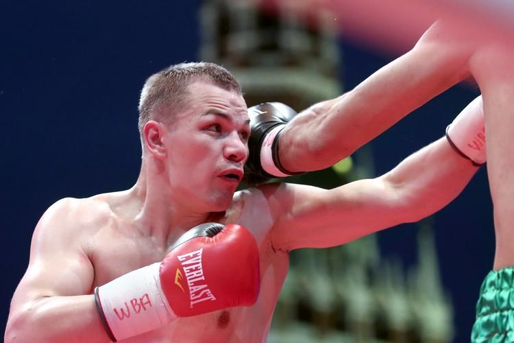 Российский боксер Федор Чудинов во время поединка в рамках Международного дня бокса на Красной площади. Фото: Валерий Шарифулин/ТАСС