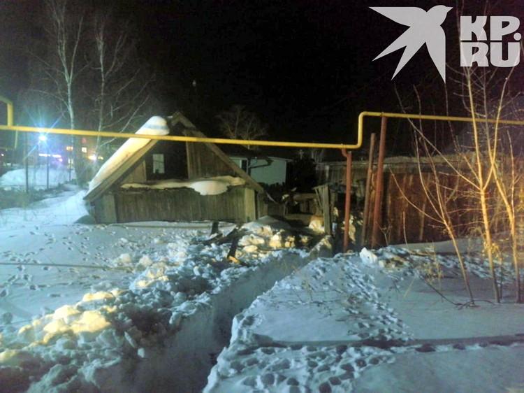 Заброшенный дом с огородом, где нашли тело пропавшего мужчины.